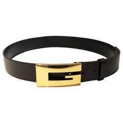 1990s Gucci logo gold buckle statement belt