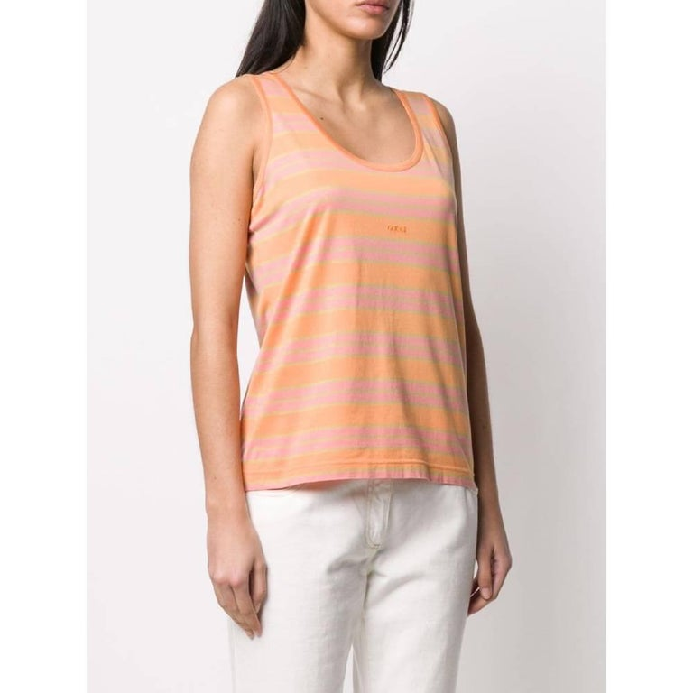 Gucci top in pink, orange and lime green horizontal striped cotton, with crew-neck, tight fit and front embroidered logo.  Years: 1990s  Made in Italy  Size: L  Linear measures  Height: 61 cm Bust: 48 cm