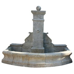 1990s Hand Carved Aged Stone Antique Reproduction Wall Fountain