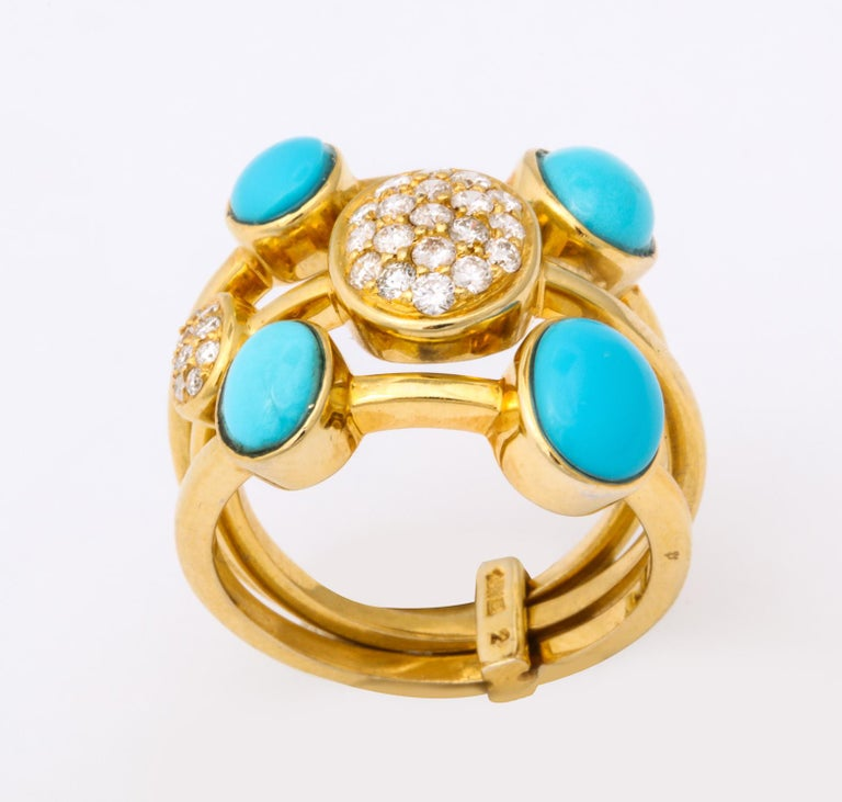 One Ladies 18kt Yellow Gold Triple Band Harem Style Flexible Ring Composed Of Three Flexible And Moveable Bands Designed With Four Bezel Set Turquoise Stones And Further Embellished With Two Pve Diamond Bezel Set Panels. Diamond Weight Approximately