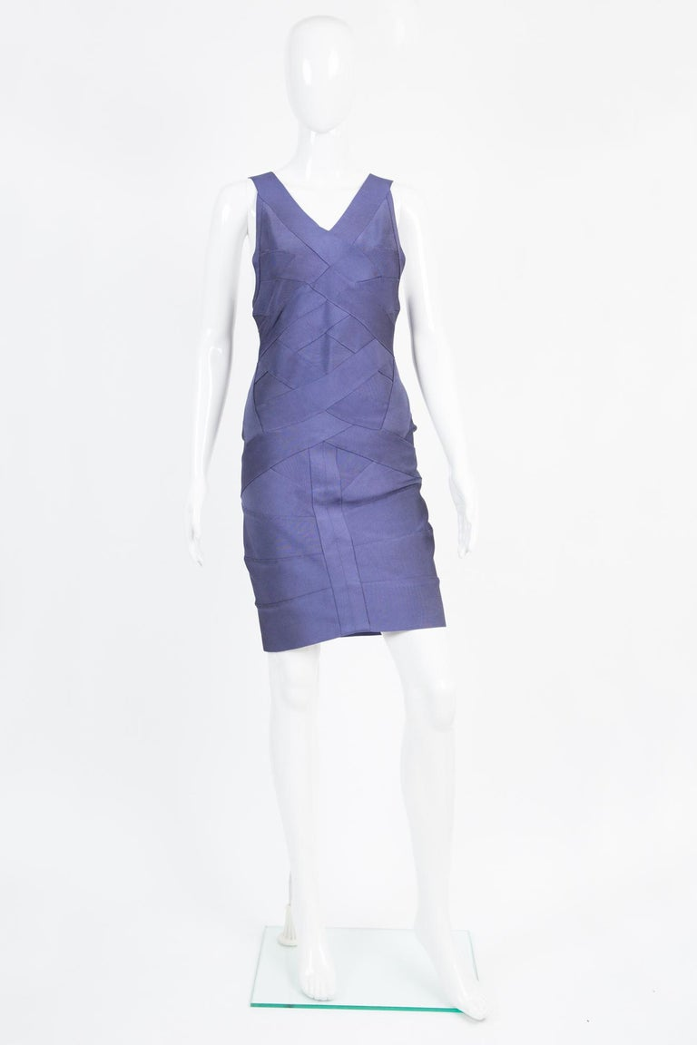 1990s Herve Leger purple knitted bandage dress featuring a short length, pleats on the body, front bands yokes details, a center back zip on a brown band.  Composition :90% rayon, 9% nylon, 1% lycra Size labe:l L Unworn, with tag attached In