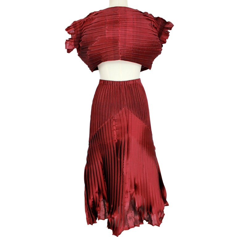Issey Miyake Fete women's vintage skirt suit. Double long veil skirt and satin pleated bolero. High waist skirt with elastic. Red Purple, 100% polyester. 1990s. Made in Japan. Like new excellent vintage condition.  Size: XS /S It 4 US 6 UK 2