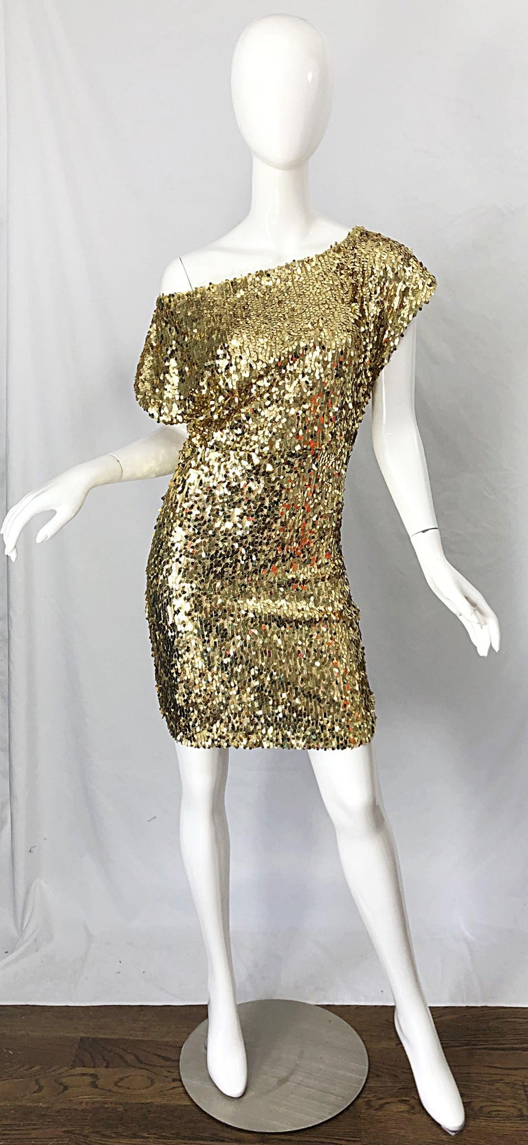 Sexy late 1990s Italian gold sequined off-the-shoulder dress ! Features thousands of hand-sewn sequins throughout the entire dress. Can be worn many ways ( as pictured ). Hidden zipper up the side with hook-and-eye closure. Perfect with sandals or