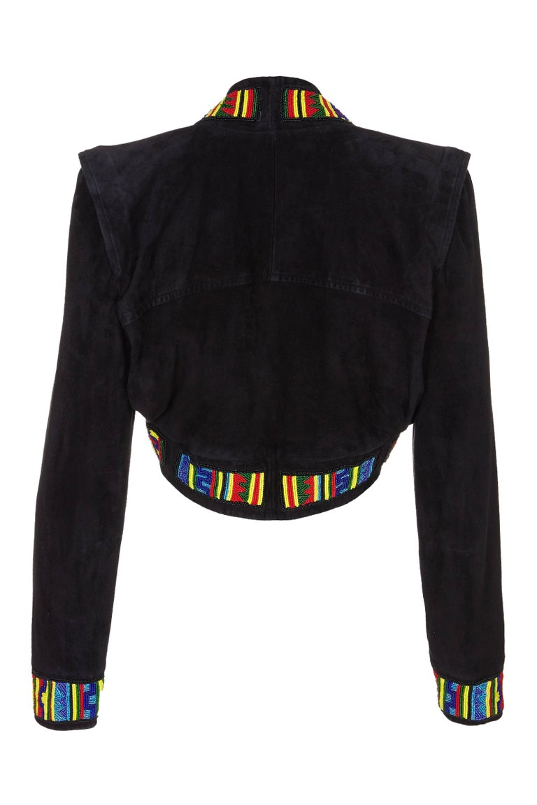 This desirable late 1980s or early 1990s  black suede bolero style jacket with multi coloured beaded trim is by luxury leather designer Jean Claude Jitrois.  His work is synonymous with intricately embellished leatherwear of exceptional quality.