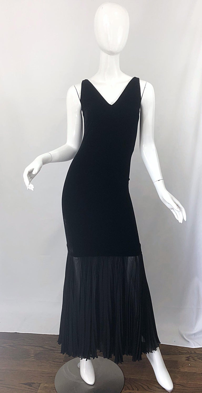 Sexy 1990s Avant Garde JEAN PAUL GAULTIER black bodycon velvet mermaid gown! Features a fitted body , with shoulder straps that give off the impression that it is a strapless dress with exaggerated bodice. Semi sheer accordian pleated chiffon hem