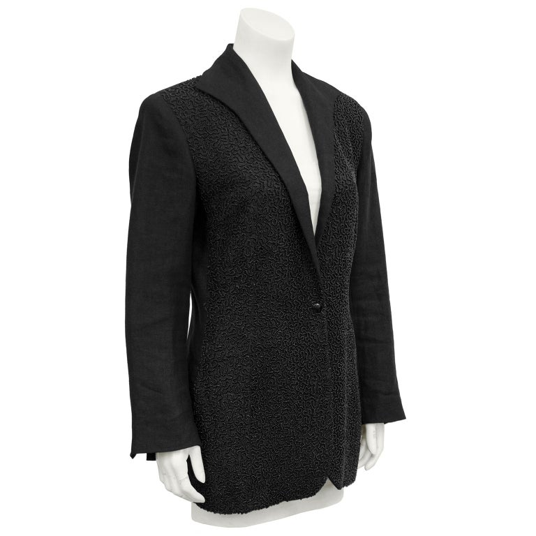 1990s Jean Paul Gaultier black linen blazer. Front entirely embellished in tiny metallic grey beadings in an allover design. Single front black button. Elongated, curved lapel. Five matching black buttons at cuffs. Blazer is equestrian style,