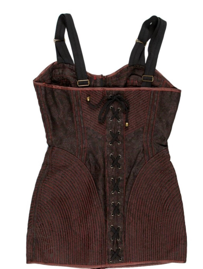 Jean Paul Gaultier maroon and black floral mini dress with lace up back and hook eye front and quiltiing. Condition: Excellent.  Size S/ US 4 28