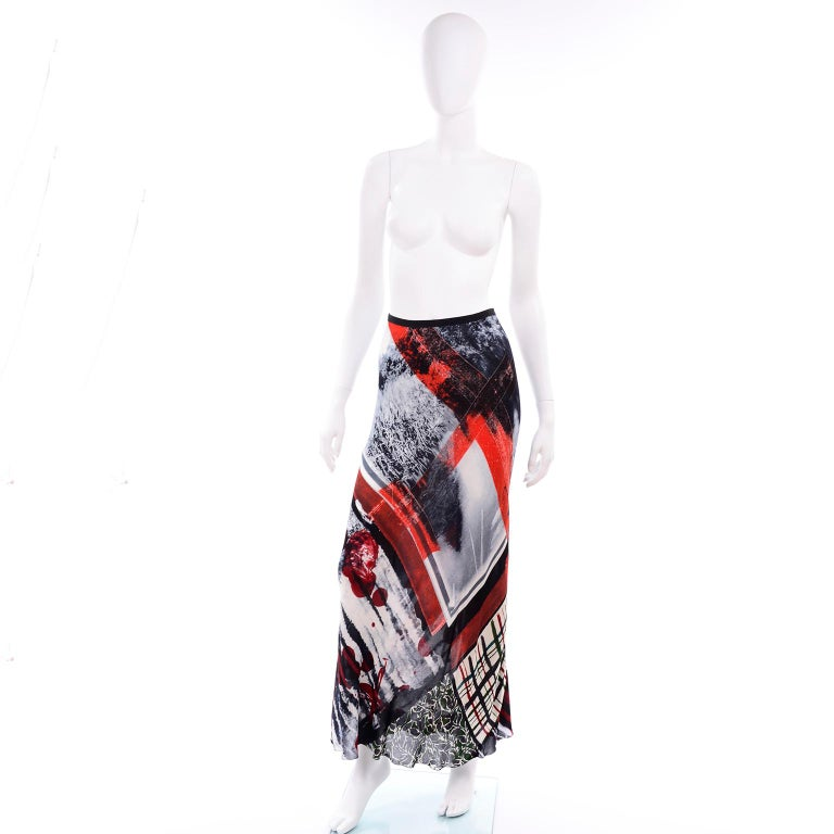 This is a beautiful semi sheer rayon vintage skirt from Jean Paul Gaultier from the late 1990's.  This fabulous abstract pattern red black and white skirt closes with a back zipper.  The skirt was made in Italy and is labeled a size 8.   WAIST:  28