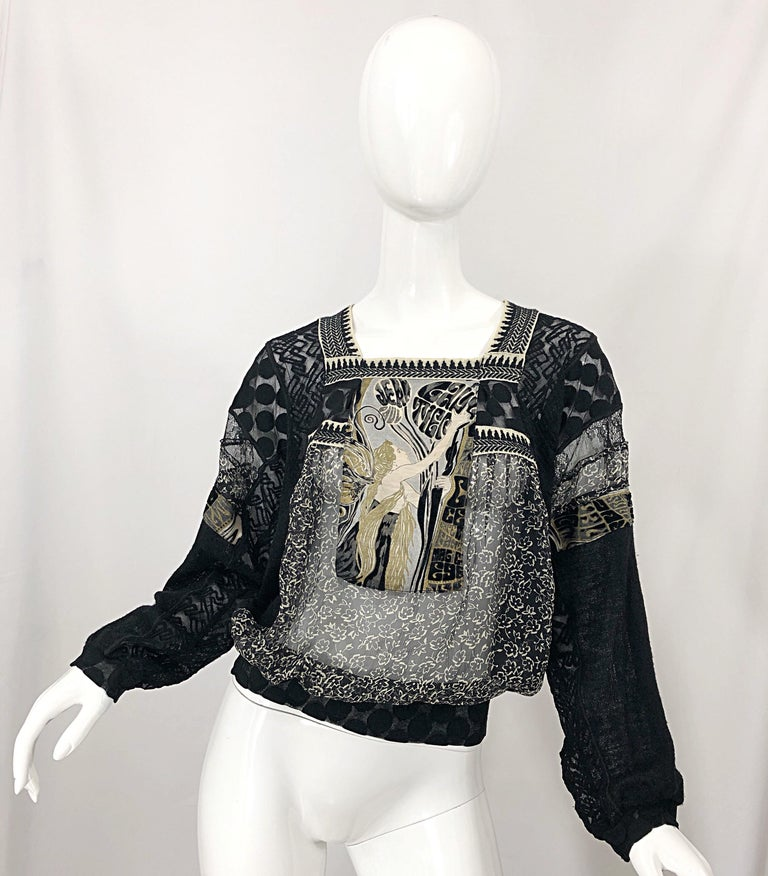 Incredible vintage 90s JEAN PAUL GAULTIER hand painted Rapunzel sheer top! Features a Rapunzel character hand painted in gold on the front. Sheer black and invory floral print sheer chiffon. Signature mesh fabric mixed throughout. Simply slips over