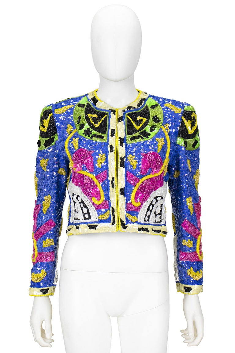 Jeanette Platinum jacket  Black silk with multi-color sequins and beading in a unicorn design  Hook and eye closures  Size S Made in the USA  Has tag with signature and the date December 17, 1992   *Please feel free to contact us with the