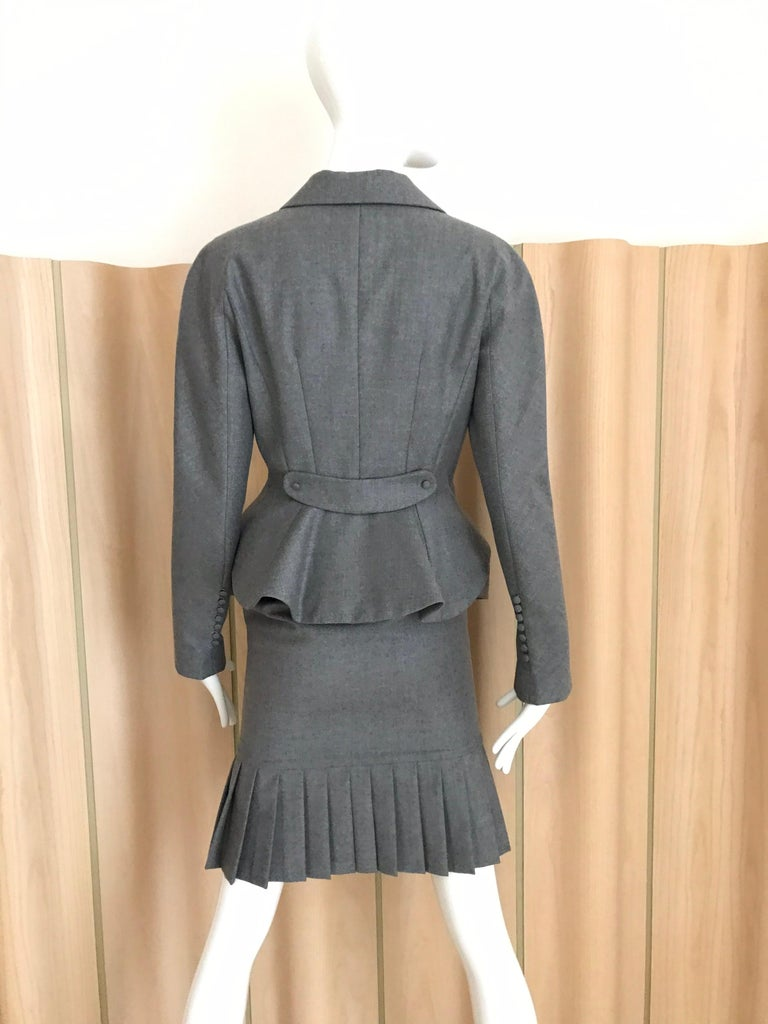 "90s John Galliano Grey Cashmere Wool Peplum Suits lined in silk. Jacket size fit size 4 : Bust: 34 inches/ Waist: 28"" / Hip: 32"" Skirt waist: 26 inches/ Hip: 34 inches/ Skirt length: 28.5"""