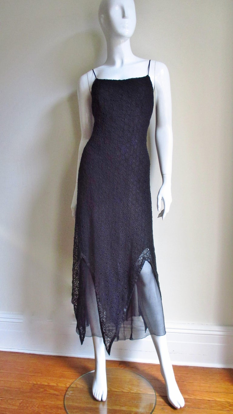 A fabulous slip style black silk dress by Karl Lagerfeld.  It consists of 3 layers one of lace with leather trimmed points at the hem over a layer of sheer silk with a straight hem over another layer of silk with points at the hem.  Quite fabulous.