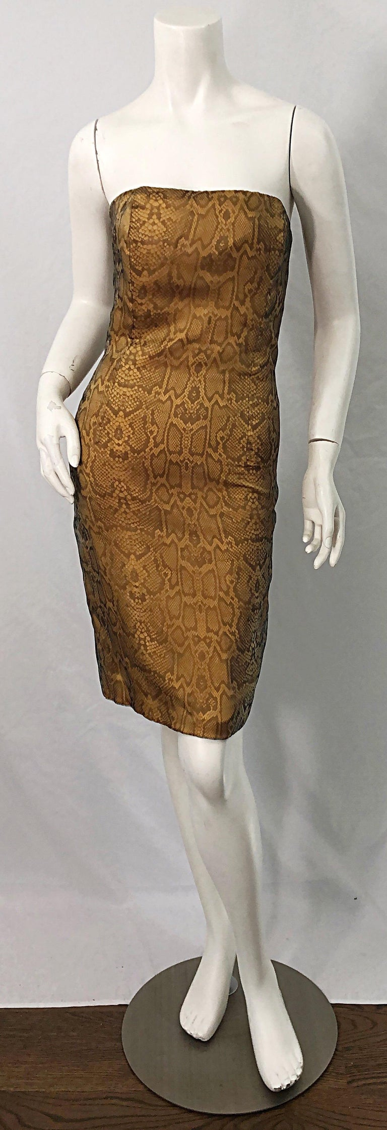 Sexy, yet sophisticated 1990s LUCA LUCA strapless snake skin print silk organza strapless dress ! The perfect alternative to the little black dress. Features an allover animal print. Hidden zipper up the back with  hook-and-eye closure. Fully lined.