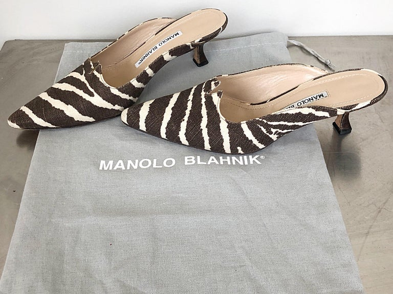Rare musuem worthy vintage early 90s MANOLO BLAHNIK zebra print brown and ivory Irish linen and leather kitten heel mules! Signature Blahnik silhouette with Avant Garde cut-out detail. Super comfortable, and effortlessly stylish. Can easily be worn