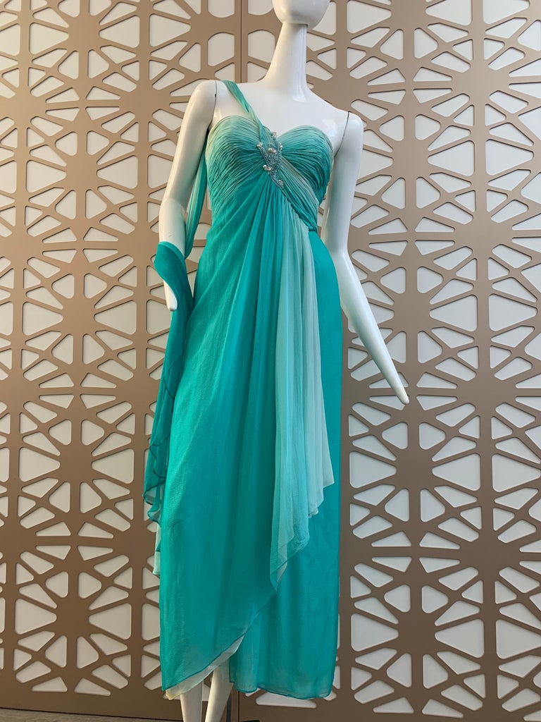 A sexy 1990s Michael Casey aquamarine color ombre silk goddess gown with ruched and beaded strapless, structured bodice:  tucked and gathered over entire bodice, the center beading and faux pearls anchor an stream of silk ombre chiffon over the