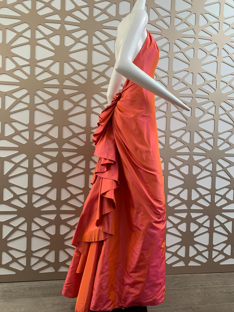 A gorgeous 1990s Michael Casey Couture coral/pink sharkskin taffeta halter gown with daring low back and ruffle bustle effect train. Neckline is beaded w/ rhinestones. Fits an ample bust. Size 6.