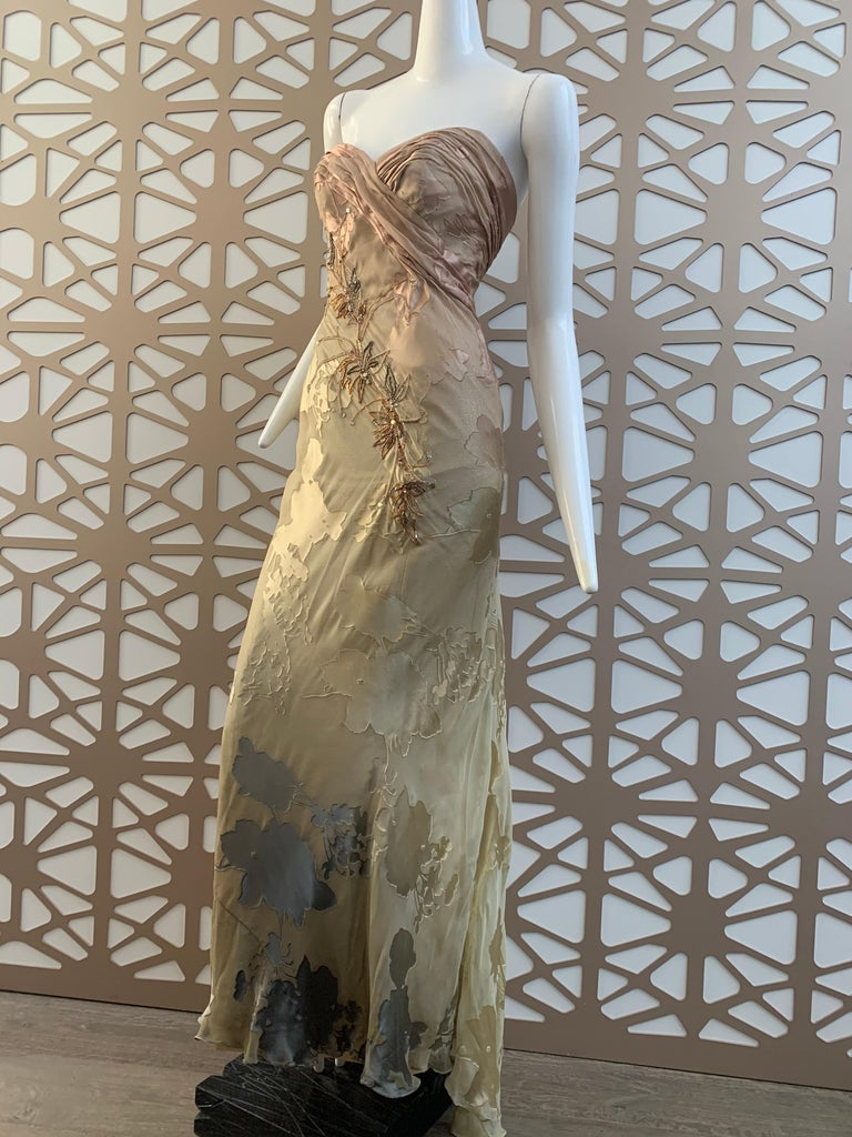 A lovely 1990s Michael Casey silk ombre botanical-patterned silk chiffon strapless gown with ruching and gathering at bodice.  Asymmetrical delicate bronze toned bamboo leaf beaded garland at front. Boned and lined in gold silk lame. Train wraps