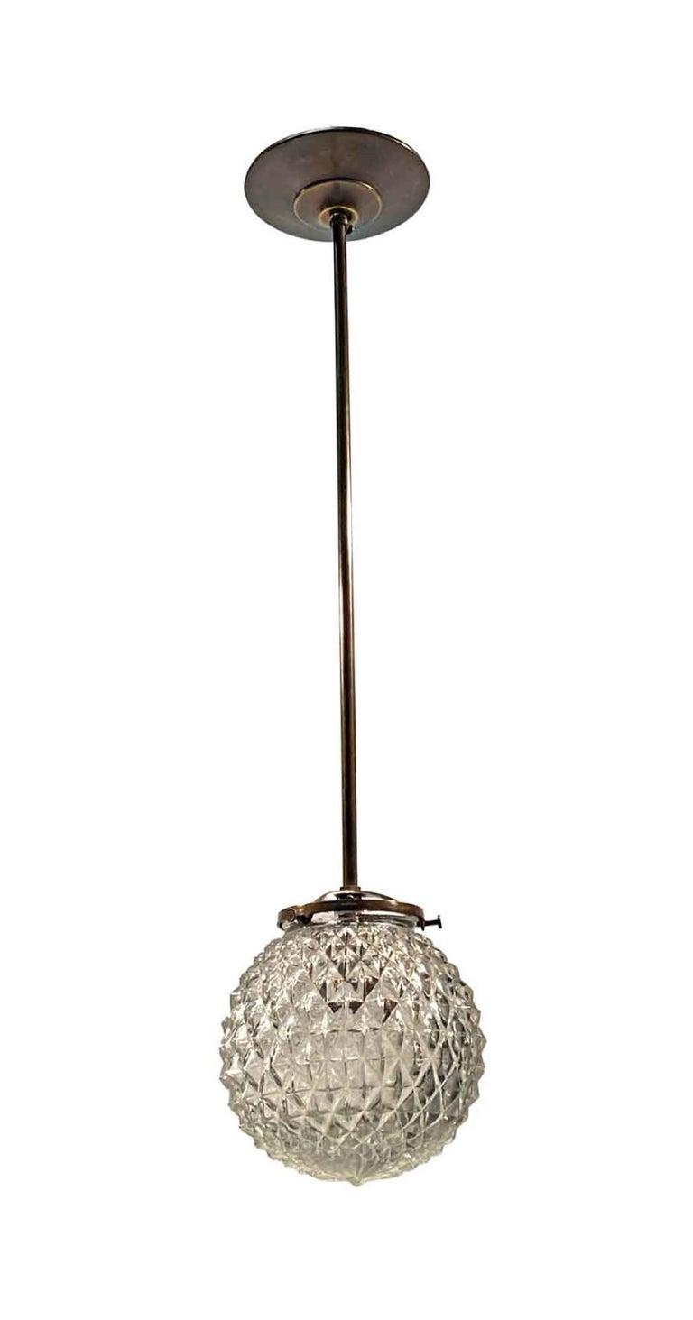 Cast 1990s Mid-Century Modern Globe Brass Pendant Light Textured Glass For Sale
