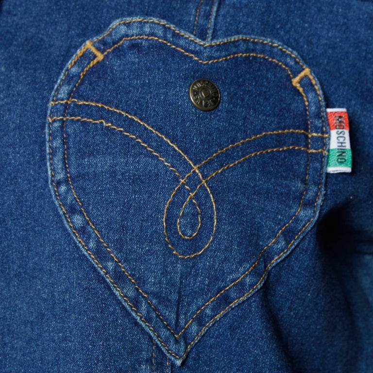 Vintage denim shirt or jacket with a heart pocket and snap up front by Moschino Jeans. Unlined with front pockets and front snap closure. Fabric: 98% Cotton/ 2% Elastic. The marked size is  I 44/ US 10/ F 40/ GB 14/ D 40 and the top fits like a