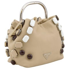 1990s Prada Beige Leather Mini Bucket Clutch with Large Bead Embellishments
