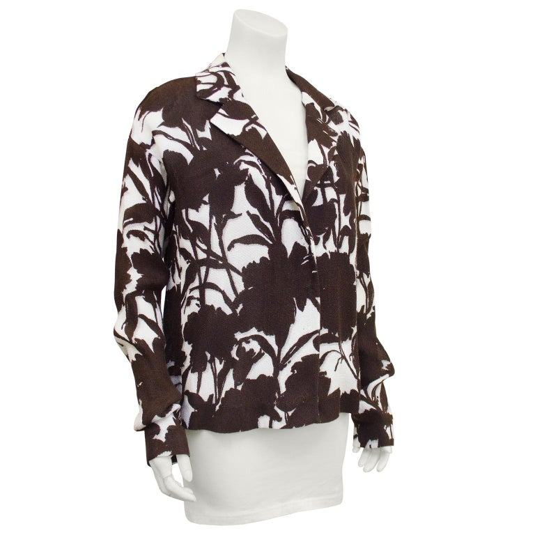 1990's Prada linen relaxed fit jacket. All over floral print in contrasting chocolate brown and cream. Notched collar, dropped shoulders and elongated sleeves. Unlined. Excellent vintage condition.  Perfect spring and summer transition piece. Closes