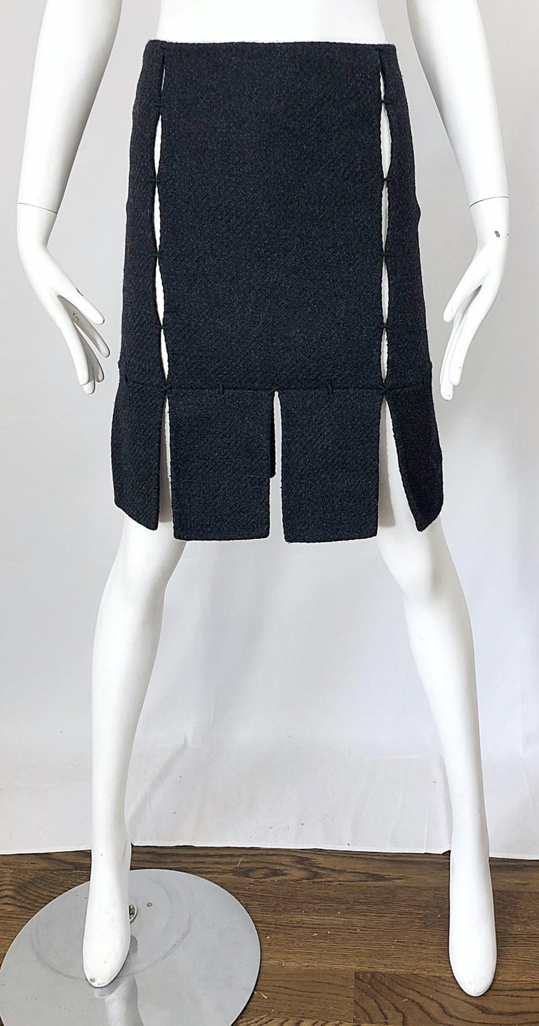 Rare late 90s PRADA charcoal gray cut-out high waisted wool pencil skirt! Features panels of wool stitched together to reveal just the right amount of skin. Chic car wash hem. Hidden zipper up the side with  hook-and-eye closure. Can easily be