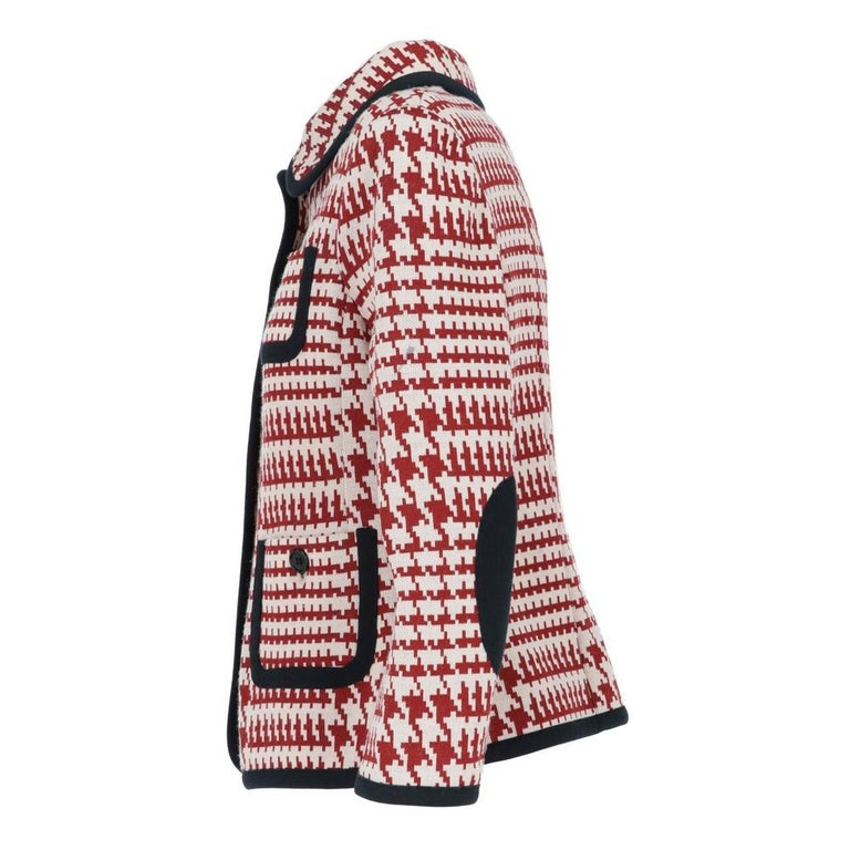 Prada wool blend jacket with red and white geometric pattern. Page collar, front buttoning and four patch pockets. Long sleeves, elbow patches and finished edges.  The item is vintage, it shows light signs of wear as shown in the pictures.  Years: