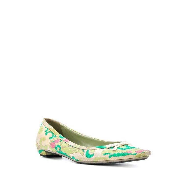 Prada pointed ballet flats in jacquard in shades of light green, dark green and pink. Insole in leather with logo.  The item shows slight halos, as in the picture.  Years: 2000s  Made in Italy  Size: 38 EU  Length insole: 26 cm