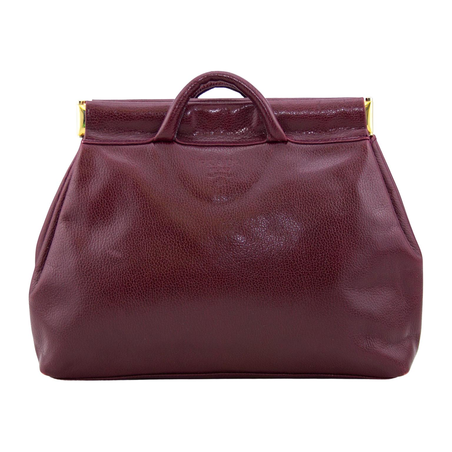 1990s Prada Maroon Leather Clutch with Small Handles