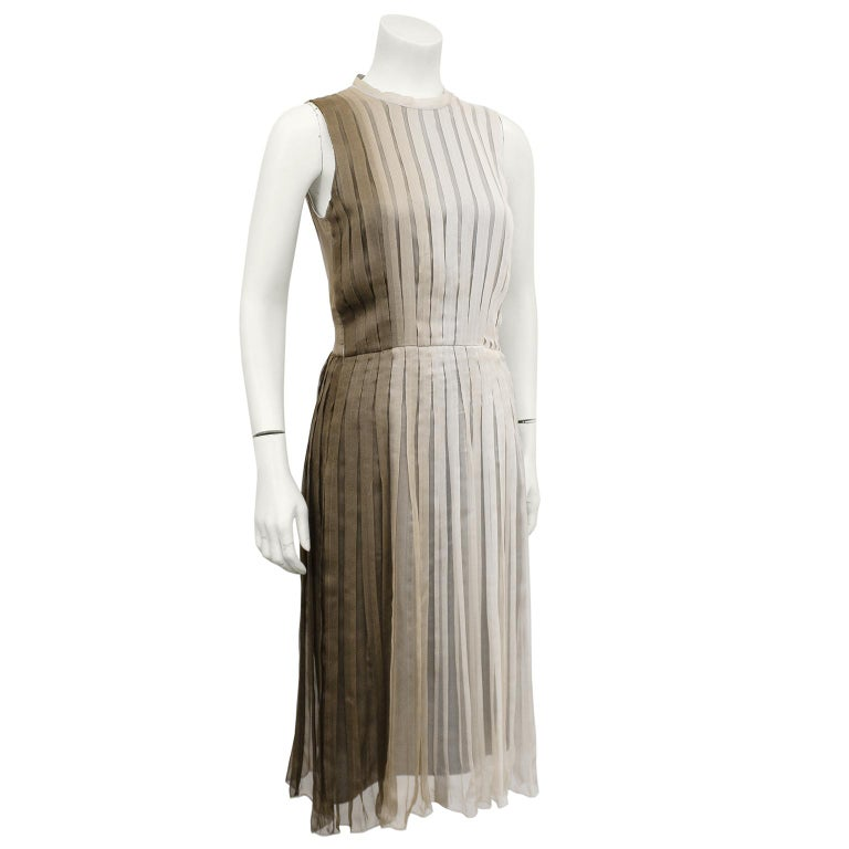 Beautiful 1990s Prada taupe ombre pleated chiffon dress. Woven ombre dyed silk tape crew neckline with top stitching details. Slight A line shape with accented waist. The ombre goes from taupe on the right to light mocha on the left. No pleats on