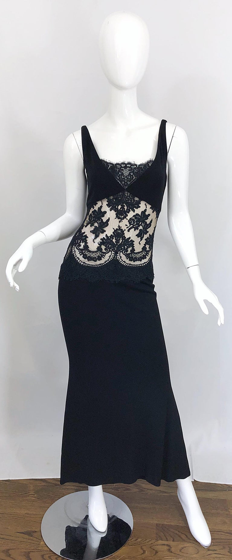 Sexy 1990s RANDOLPH DUKE Couture black cut-out evening gown dress! Features a soft double ply rayon/silk blend fabric that offers some stretch. Sheer black lace panels at front and back reveal just the right amount of skin. Tailored bodice with a