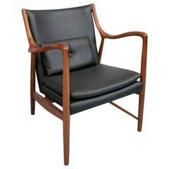 1990s Re-Edition Wood and Leather Armchair by Danish Designer Finn Juhl