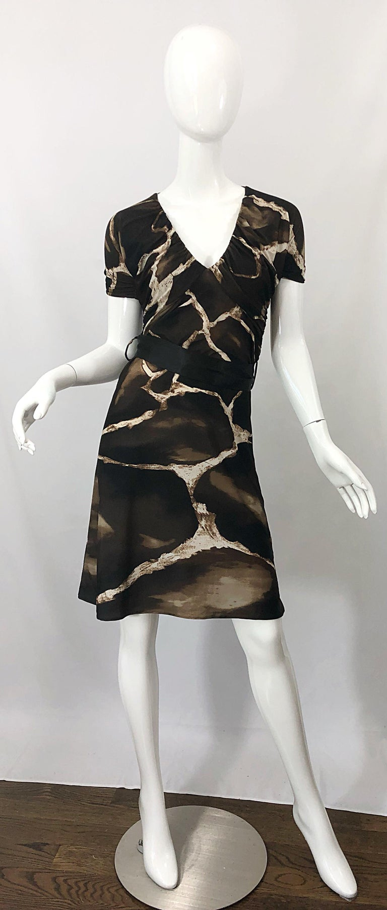 Chic and rare vintage mid / late 80s ROBERTO CAVALLI for NEIMAN MARCUS giraffe print belted short sleeve jersey dress! Features timeless giraffe animal print in chocolate brown and ivory. Flattering ruched tailored bodice and sleeves. Hidden zipper