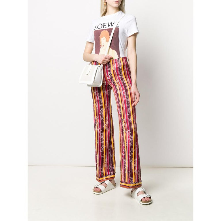A.N.G.E.L.O. VINTAGE – Italy  Romeo Gigli jacquard cotton trousers with multicolored vertical stripes. Side closure with button and zip. Flared design.  This item belongs to a deadstock, it has never been worn and comes with its original
