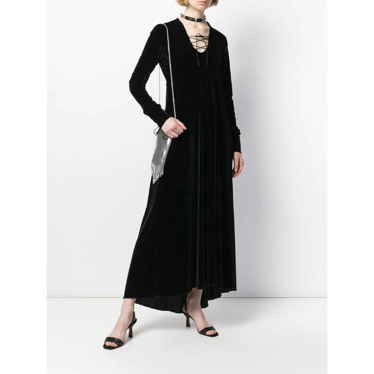Romeo Gigli long asymmetric dress in black velvet. Model with U-neck and crossed laces. Long sleeves with laces and side zip closure.  Years: 90s   Made in Italy   Size: 44 IT  Flat measurements   Height: 140 cm  Bust: 43 cm Shoulders: 48