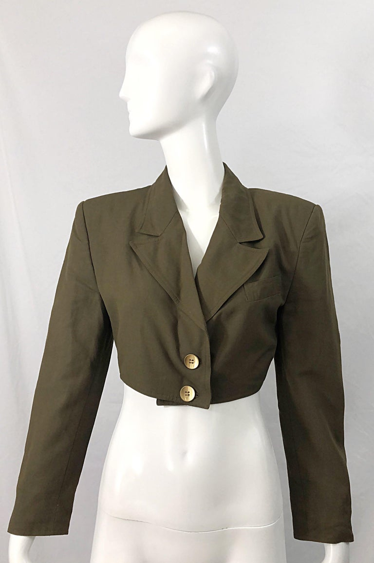 Chic 1990s ROMEO GIGLI army hunter green rayon and wool cropped blazer jacket ! The perfect army green color will match everything, and is perfect all year. Lightweight soft fabric. Great layered or alone. Fully lined. 60% Rayon 40% Wool In great