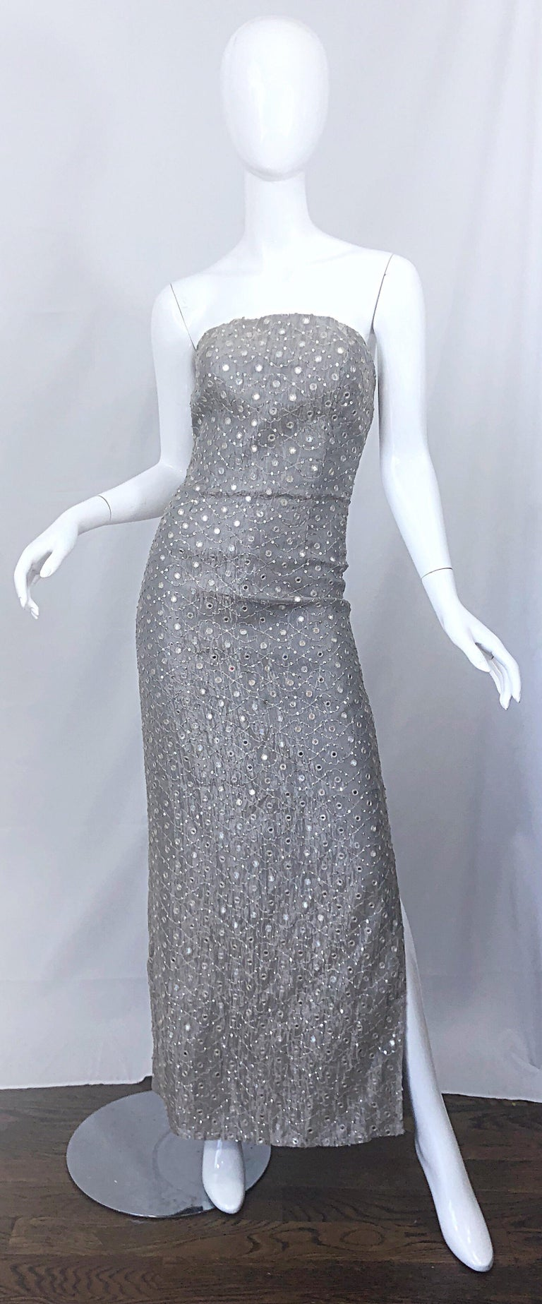 Beautiful vintage 1990s silver gray silk mirrored sequin couture strapless evening dress / gown! Features a fitted boned bodice, with a hidden zipper up the back and hook-and-eye closure. Slit up the left leg reveals just the right amount of skin. A