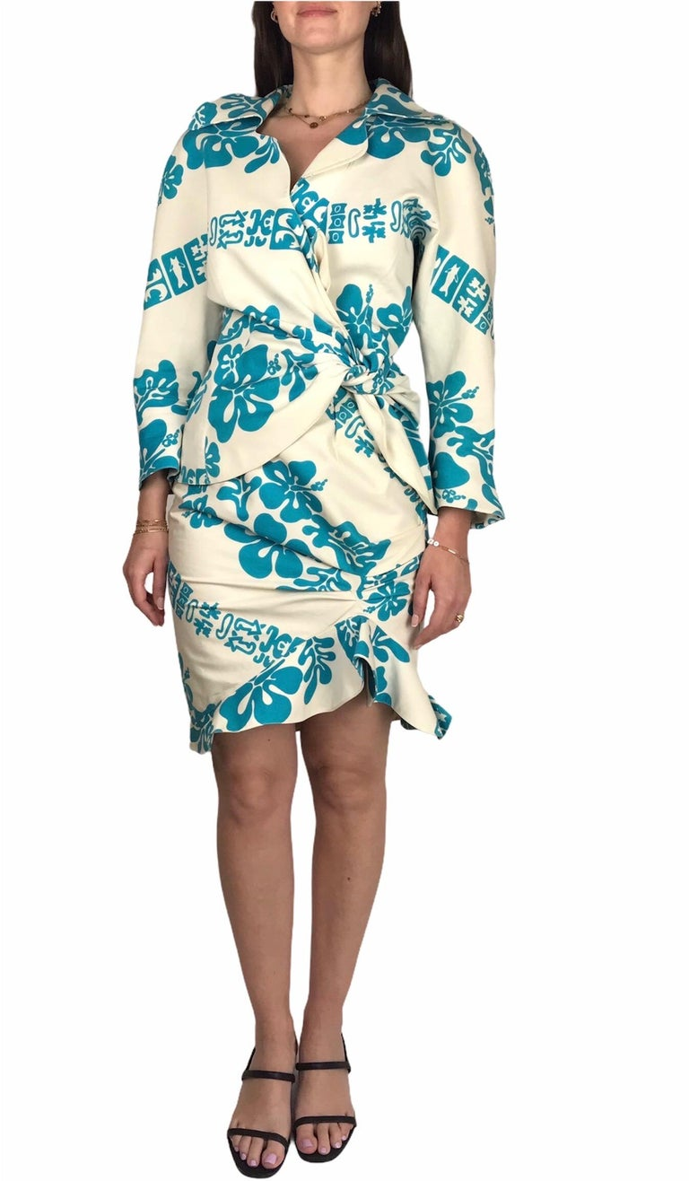 """THIERRY MUGLER, """"Été Hawaii"""" collection, Spring / Summer 1990 ready-to-wear. Made in France.  Cotton skirt suit composed of a pretty jacket that ties at the side, asymmetrical back as well. Bold shoulders - shoulder pads has been removed.  The skirt"""