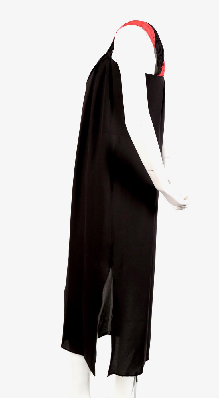 Grecian black silk dress with red pleated single shoulder from Valentino dating to the 1990's. No size is indicated however this would best fit a US 4 or French 36 or 38. Dress has an internal boned corset. Approximate measurements: bust 33-34
