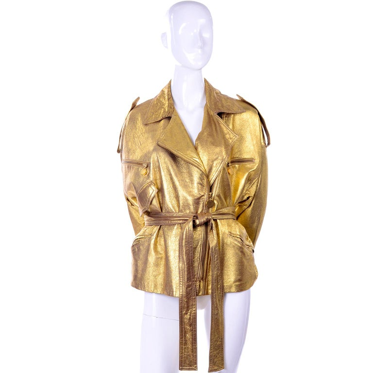 This is an incredible oversized early 1990's vintage Donna Karan gold leather jacket with a matching leather belt. We love the drama of this iconic piece and the semi distressed brilliant gold leather.  The  jacket is  marked as size 10 but can