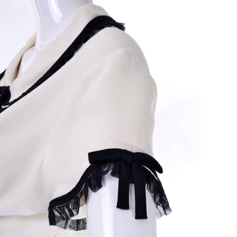 Women's 1990s Vintage Moschino Ivory Crepe Dress With Black Tulle Net Ruffle Trim & Bow For Sale