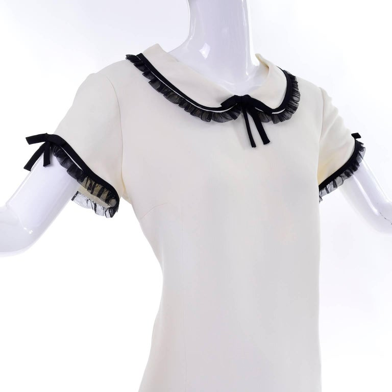 1990s Vintage Moschino Ivory Crepe Dress With Black Tulle Net Ruffle Trim & Bow For Sale 1
