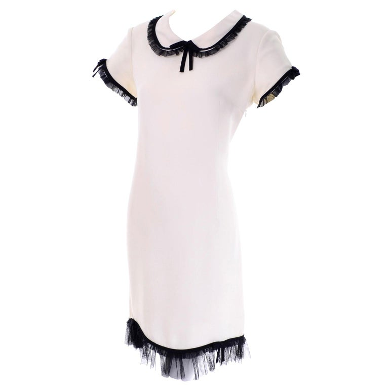 1990s Vintage Moschino Ivory Crepe Dress With Black Tulle Net Ruffle Trim & Bow For Sale