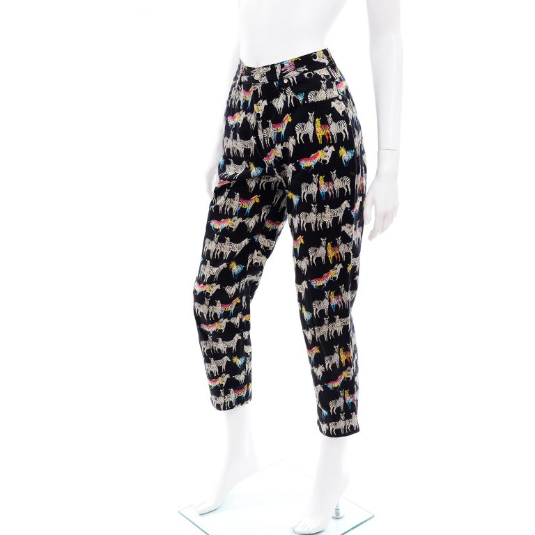 This 1990's pair of Versace Jeans Couture pants is in a very unique ombre or rainbow Zebra print!  These peg legged  jeans have all of the expected silver medusa hardware and close with a front zipper.  They are made of 100% Cotton and are labeled a