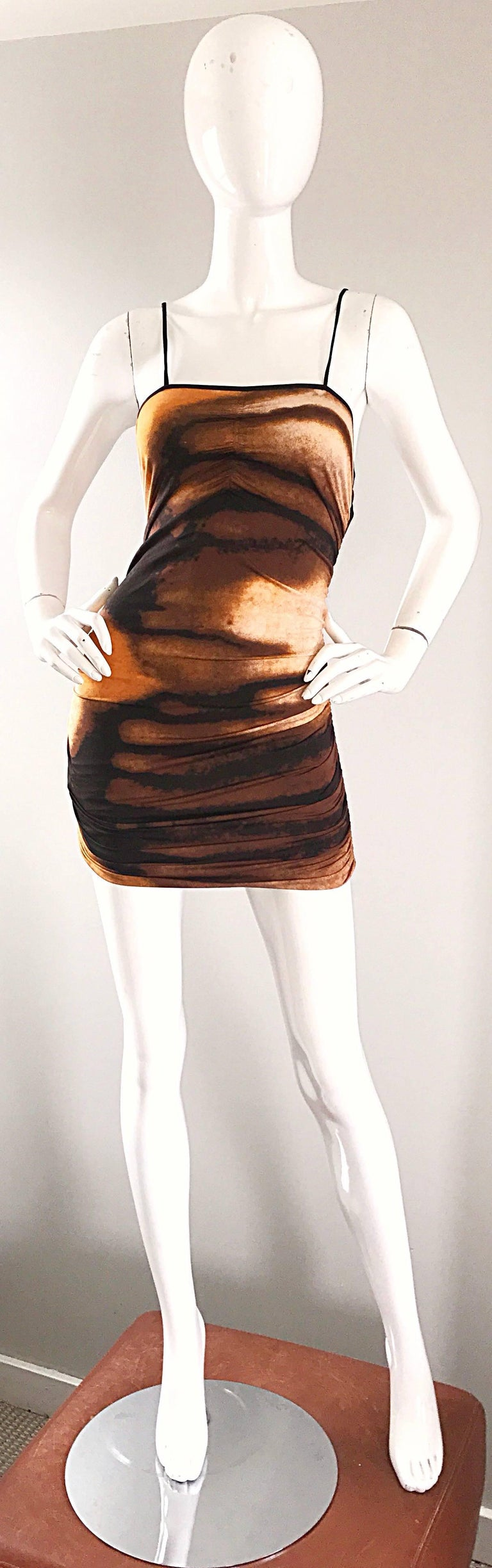 Sexy early 1990s VIVIENNE TAM abstract ruched bodycon mini dress! Features flattering and unique blurred brush strokes of brown, burnt orange, black and ivory throughout. Slimming ruched details down both sides of the dress. Simply slips over the