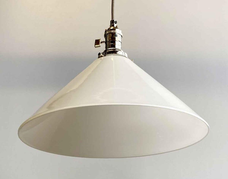 1990s white glass cone glass shade pendant light. Features new polished nickel finish hardware. Small quantity available at time of posting. Please inquire. Priced each. This can be seen at our 400 Gilligan St location in Scranton. PA.