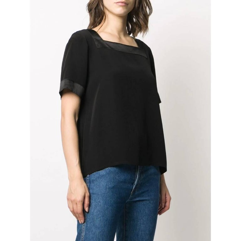 Yves Saint Laurent top in black acetate and viscose, square neckline and short sleeves. Years: 90s  Made in France  Size: 44 FR  Linear measures  Height: 57 cm Shoulders: 40 cm Bust: 49 cm