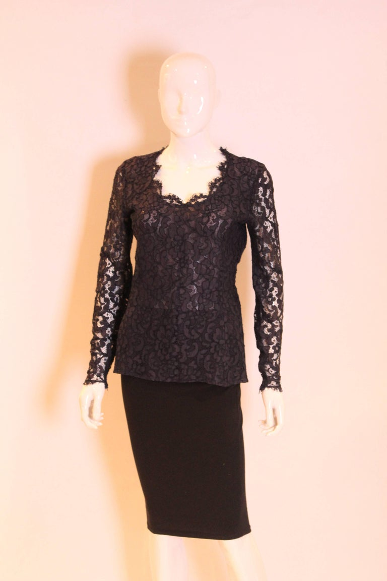 An elegant navy lace top for summer from Yves Saint Laurent, Rive Gauche line. The top has a sweetheart neckline, fitted body and long sleeves. The body is lined. The top as a side zip opening, and zip opening at the sleeves.