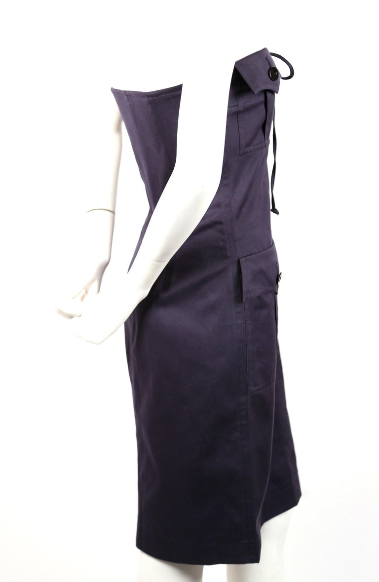 Navy blue, strapless, cotton, safari dress designed by Yves Saint Laurent dating to the early 1990's. French size 38. Best fits a US 2 or small-busted 4. Dress can be adjusted with ties but is best for a 31-33