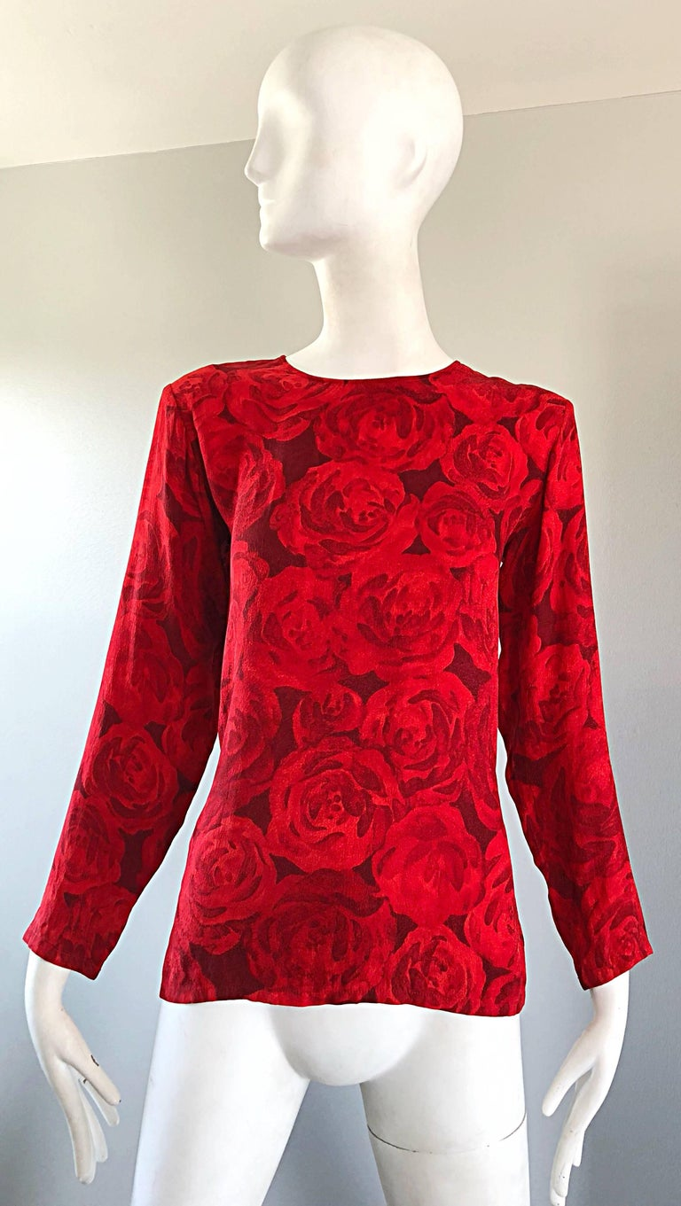 Beautiful 1990s YSL YVES SAINT LAURENT 'Rive Gauche' lipstick red rose print long sleeve silk blouse! Features a gorgeous rose print with a wonderfully tailore fit. Simply slips over the head with a single button closure at top back neck. Can easily